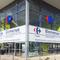 Décoration adhésive sur hall d'entrée de Carrefour le Crès (34). Impression numérique HD sur vinyle microperforé ou vision 1 sens pour communiquer sur les horaires. Signarama Montpellier