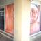 Décoration adhésive sur vitrines. Impression sur microperforé pour communiquer de l'extérieur et voir de l'intérieur pour cet institut de massages de Sète.  Signarama Montpellier.